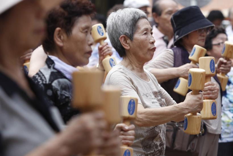 Japan's Demographic Doom. (Photo: Reuters) Women exercise with wooden ...