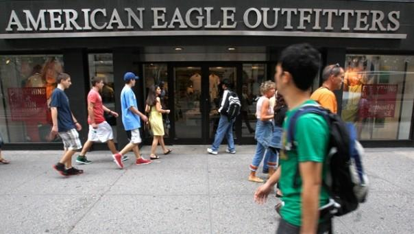 Pedestrians walk past an American Eagle Outfitters store in New York
