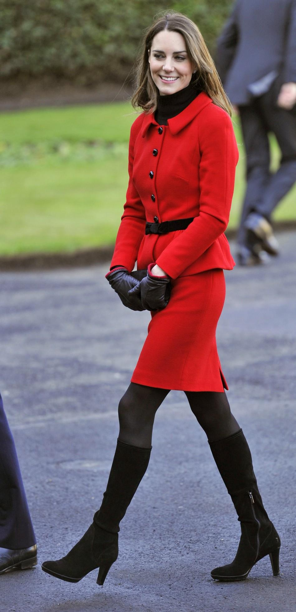"Kate Middleton returns in ""Red Regal"" style at St. Andrews."
