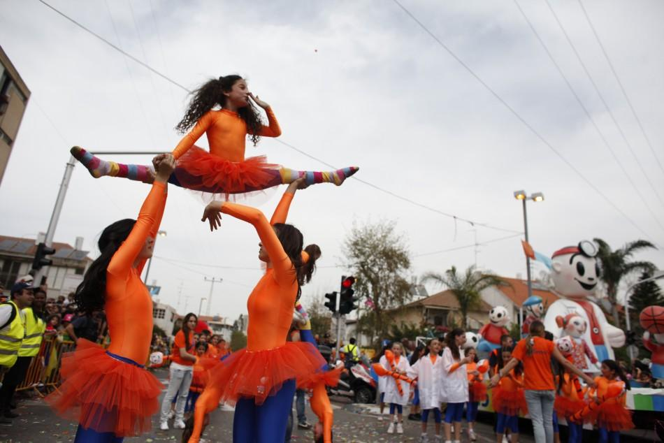 Performers take part in an annual parade for Purim in Holon