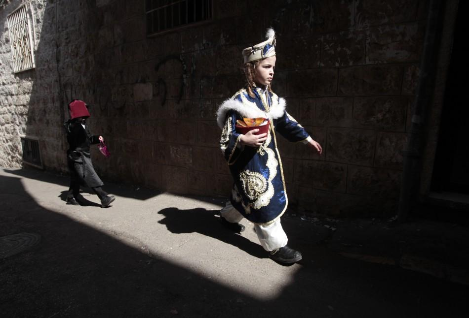 Ultra-Orthodox Jewish boys wear costumes during celebrations for the Jewish holiday of Purim in Jerusalem's Mea Shearim neighbourhood
