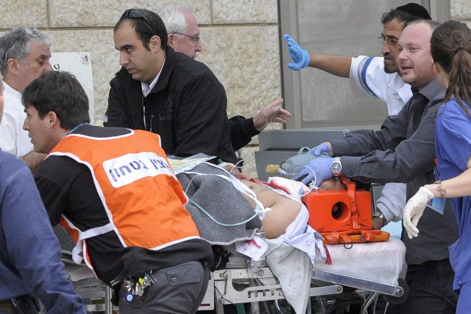 An injured man is wheeled into a hospital after an explosion in Jerusalem