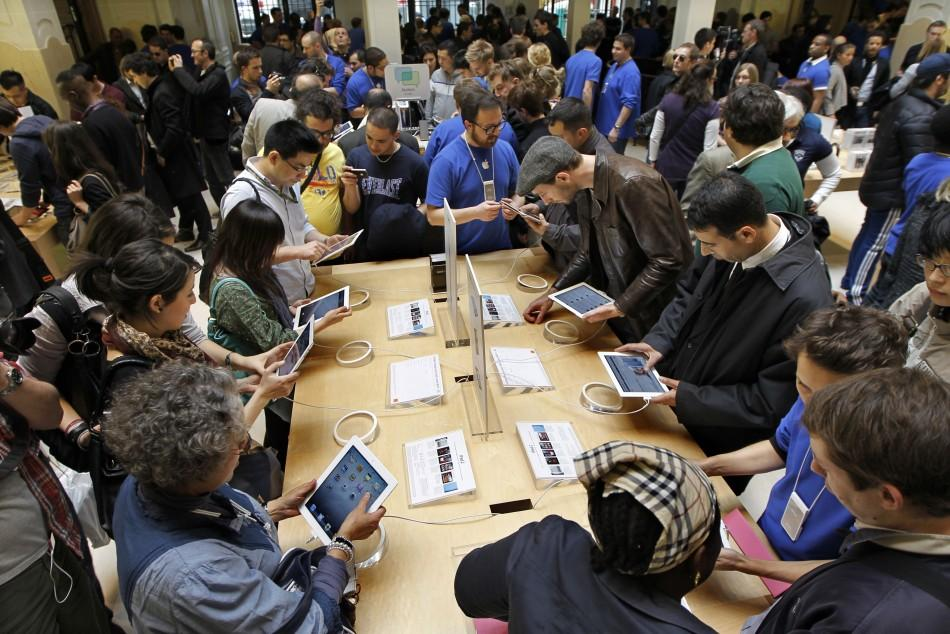 Customers discover the Apple's iPad 2 in a Paris Apple store after its official launch for direct purchase in France