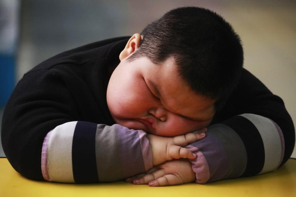 Lu Zhihao takes a nap at a kindergarten in Foshan