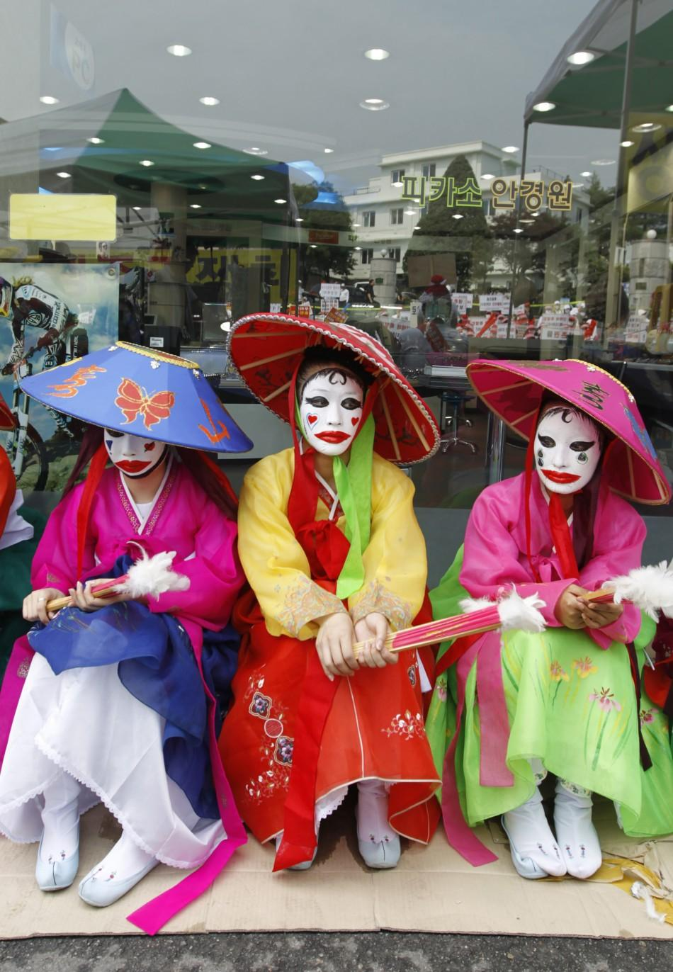 Face-painted prostitutes protest for police's crackdown on brothels