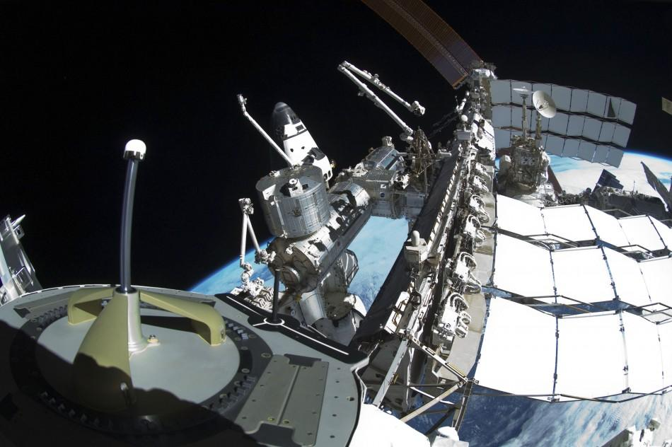 The space shuttle Endeavour is seen docked to the International Space Station in this photo taken using a fish-eye lens by spacewalking astronaut Mike Fincke.