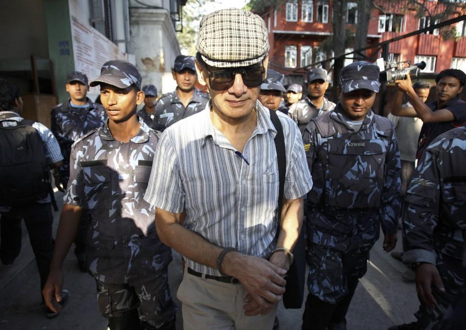French serial killer Charles Sobhraj leaves Kathmandu district court after his hearing in Kathmandu
