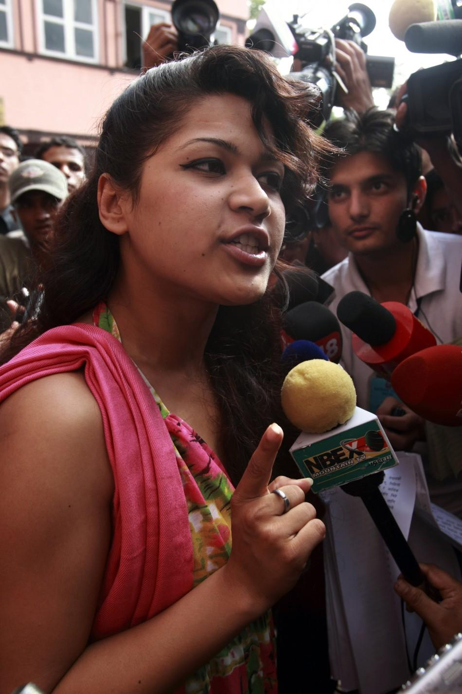 Nihita Biswas, who claims to be the wife of French serial killer Charles Sobhraj, talks to the media as she leaves the Supreme Court in Kathmandu