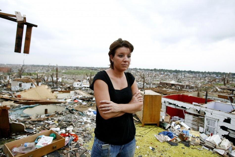 Jamie Haun looks at the damage caused by the May 22 tornado in Joplin