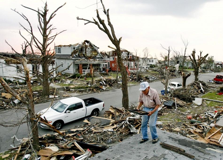 Hugh Hills salvages items from the upper level of his house which was destroyed in the May 22 tornado in Joplin
