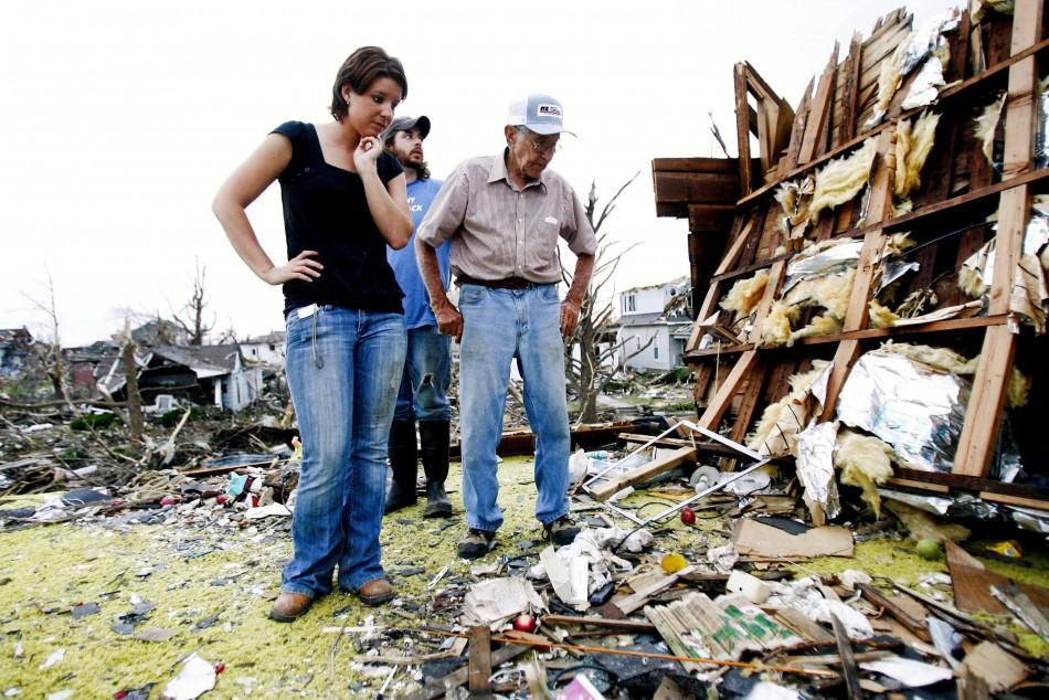Jamie Haun, William Haun and Hugh Hills survey Hill's house which was destroyed in the May 22 tornado in Joplin