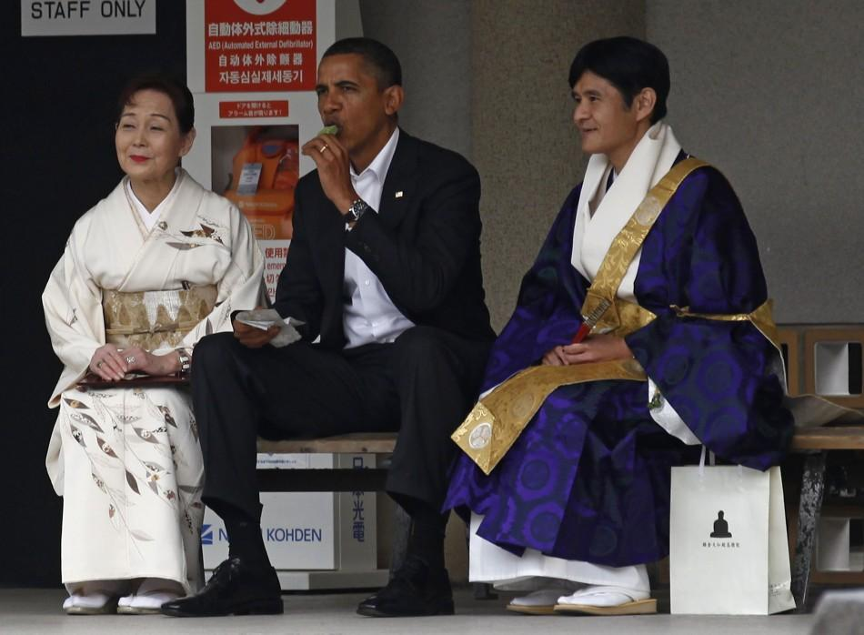 U.S. President Obama eats ice cream as he visits the Great Buddha statue in Kamakura, on the sidelines of the APEC summit