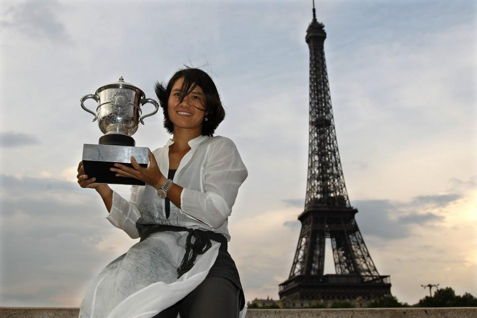 Li Na of China poses with her trophy near the Eiffel Tower in Paris after winning the French Open tennis tournament