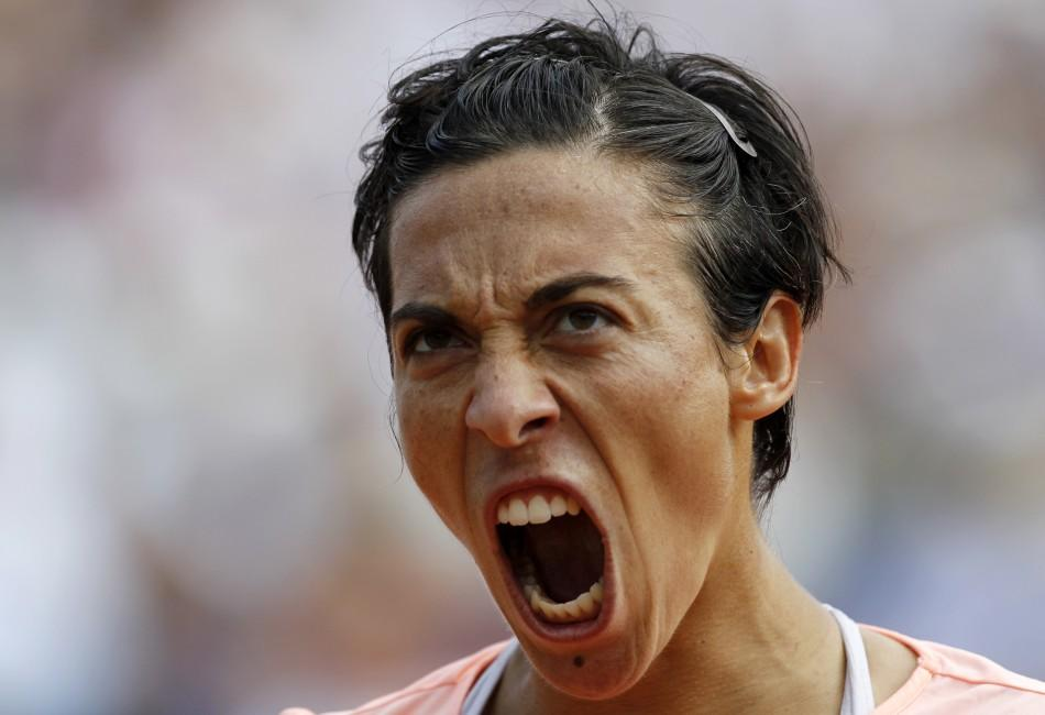 Schiavone of Italy reacts during her women's final against Li Na of China at he French Open tennis tournament at the Roland Garros stadium in Paris.