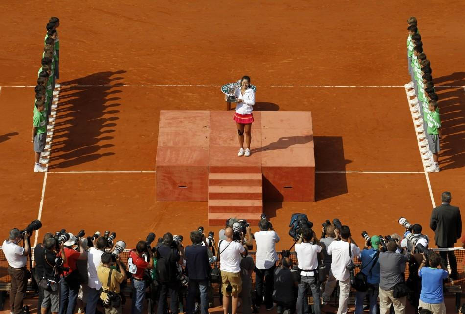 Li Na of China poses for the media with the trophy after winning her women's final against Francesca Schiavone of Italy at the French Open tennis tournament at the Roland Garros stadium in Paris.
