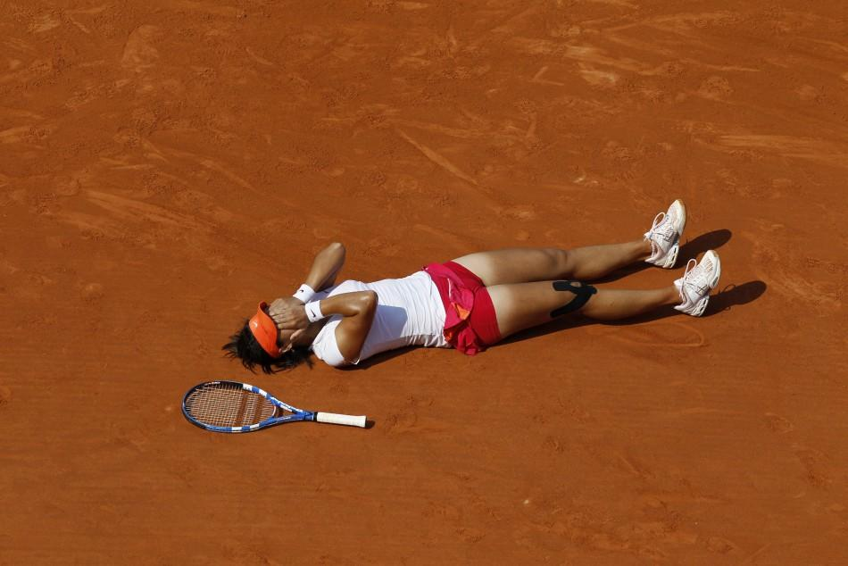 Li Na of China reacts after winning her women's final against Francesca Schiavone of Italy at the French Open tennis tournament at the Roland Garros stadium in Paris.