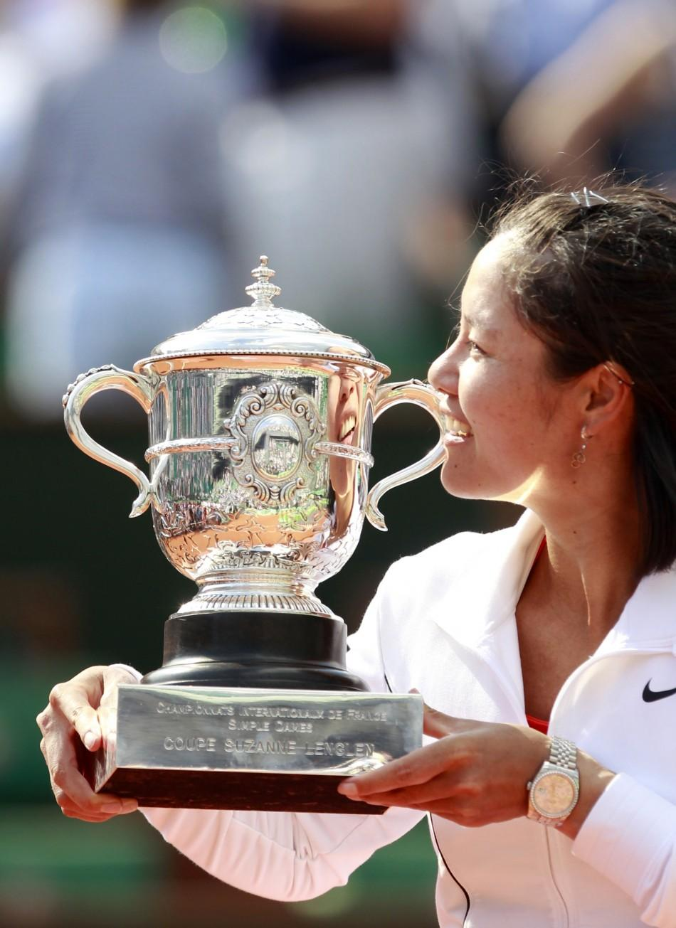 Li Na of China poses with the trophy after winning her women's final against Francesca Schiavone of Italy at the French Open tennis tournament at the Roland Garros stadium in Paris.