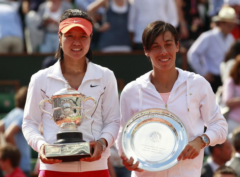 Li Na of China poses with the trophy next to Francesca Schiavone of Italy after winning the women's final at the French Open tennis tournament.