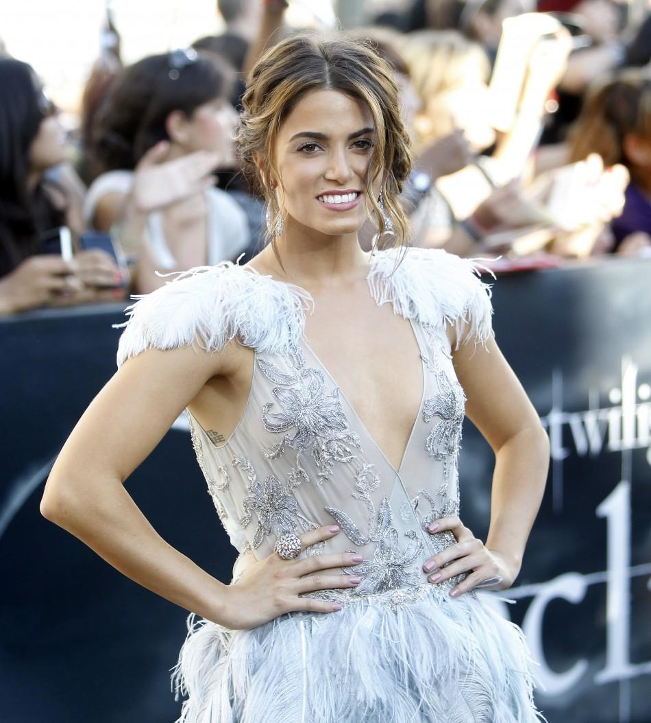 "Cast member Nikki Reed poses at the premiere of ""The Twilight Saga: Eclipse"" during the Los Angeles Film Festival at Nokia theatre at L.A. Live in Los Angeles June 24, 2010."