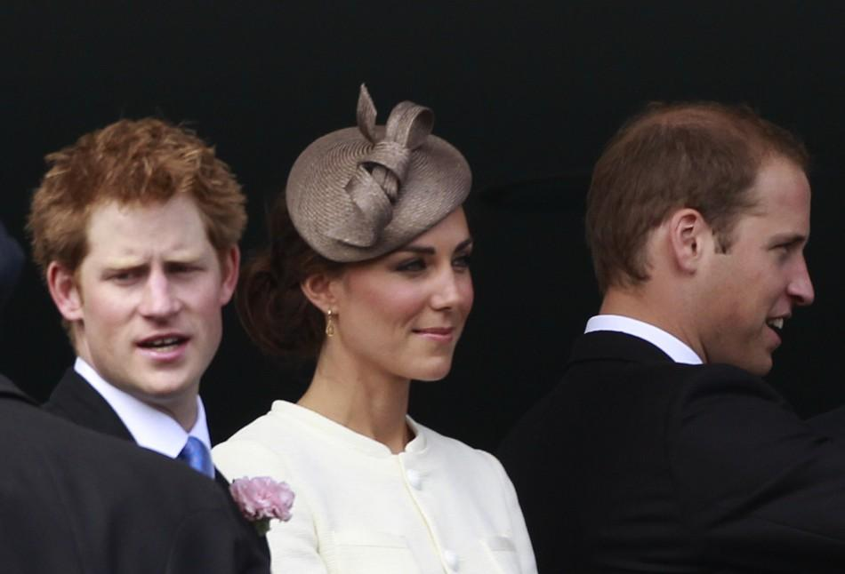 Britain's Prince Harry, Catherine the Duchess of Cambridge, and Prince William stand on the balcony of the Royal box before the Derby at Epsom Racecourse in southern England