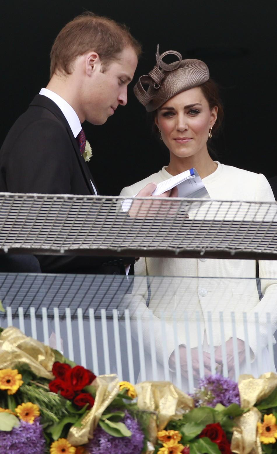 Britain's Prince William and Catherine, Duchess of Cambridge, watch the racecourse after Queen Elizabeth's horse Carlton House lost the Epsom Derby at Epsom Racecourse in southern England