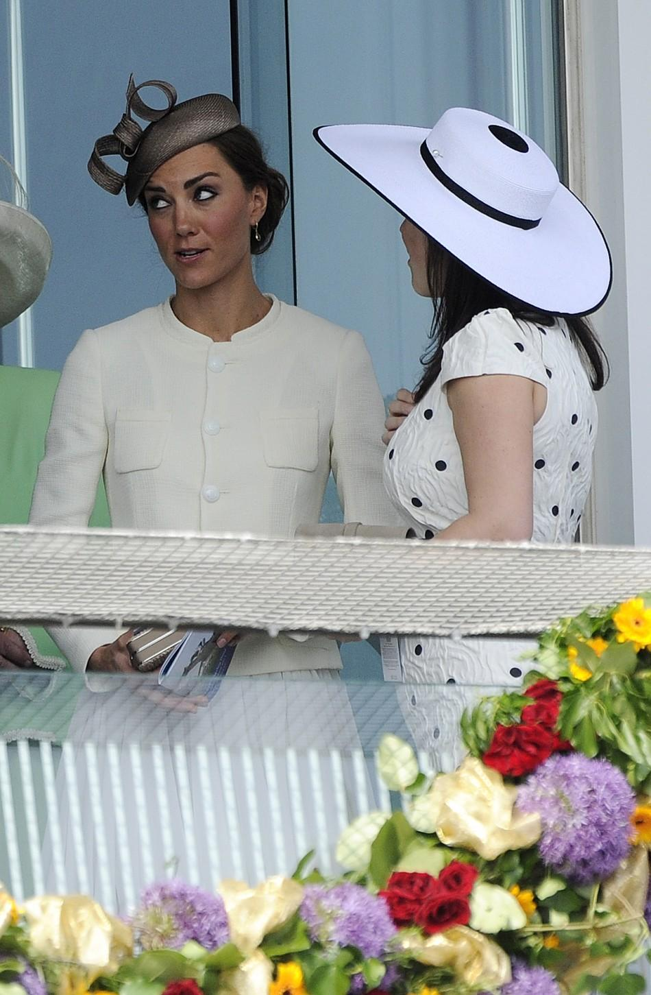 Catherine, Britains Duchess of Cambridge, stands with Britain's Princess Eugenie as they attend Epsom Derby horse race at Epsom Racecourse in southern England