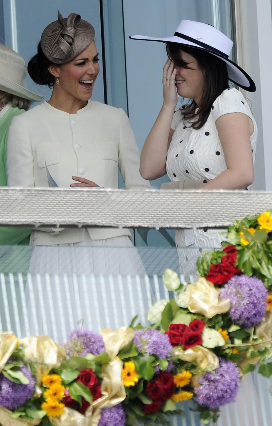 Catherine, Britains Duchess of Cambridge, jokes with Princess Eugenie as they attend Epsom Derby horse race at Epsom Racecourse in southern England