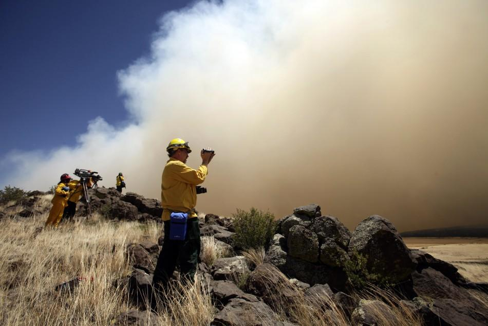 smoke billowing over the White Mountains from the Wallow Wildfire in Apache County, Arizona June 8, 2011