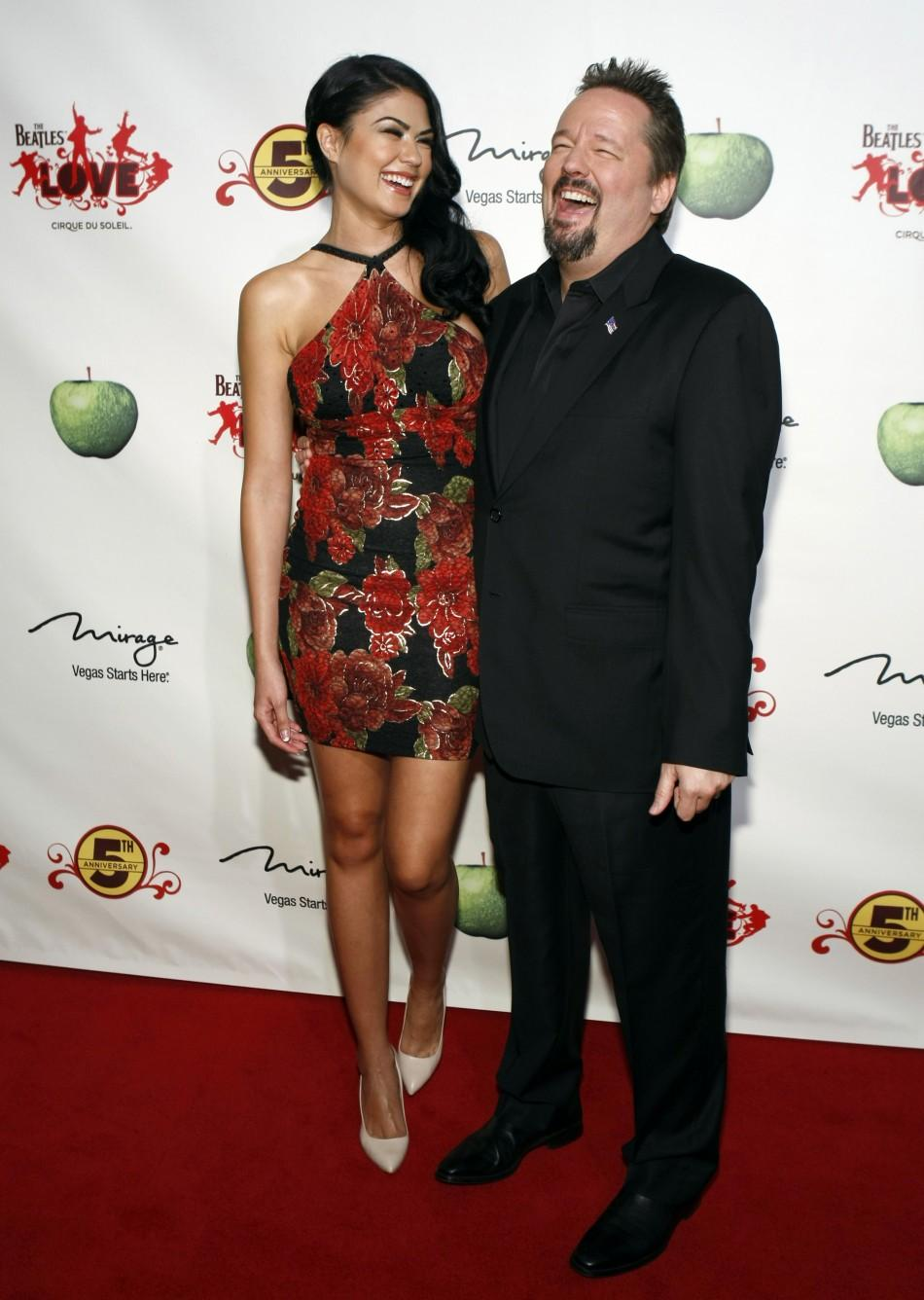 """Taylor Makakoa (L) and ventriloquist Terry Fator arrive for the fifth anniversary celebration of """"The Beatles LOVE by Cirque du Soleil"""" show at the Mirage Hotel and Casino in Las Vegas, Nevada June 8, 2011."""