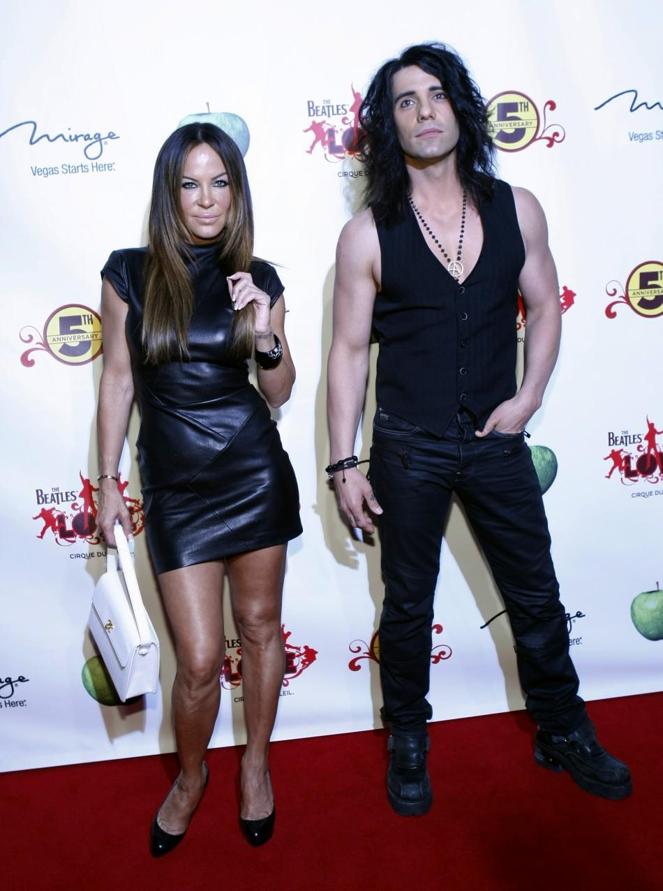 """Pussycat Dolls creator Robin Antin (L) and illusionist Criss Angel arrive for the fifth anniversary celebration of """"The Beatles LOVE by Cirque du Soleil"""" show at the Mirage Hotel and Casino in Las Vegas, Nevada June 8, 2011."""