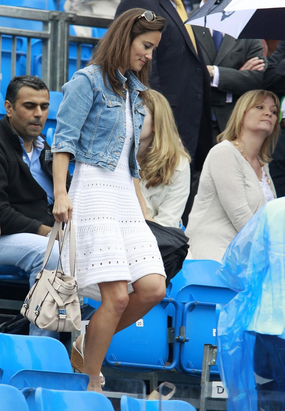 Pippa Middleton leaves the Centre Court during a rain break at the Queen's Club Championships in west London