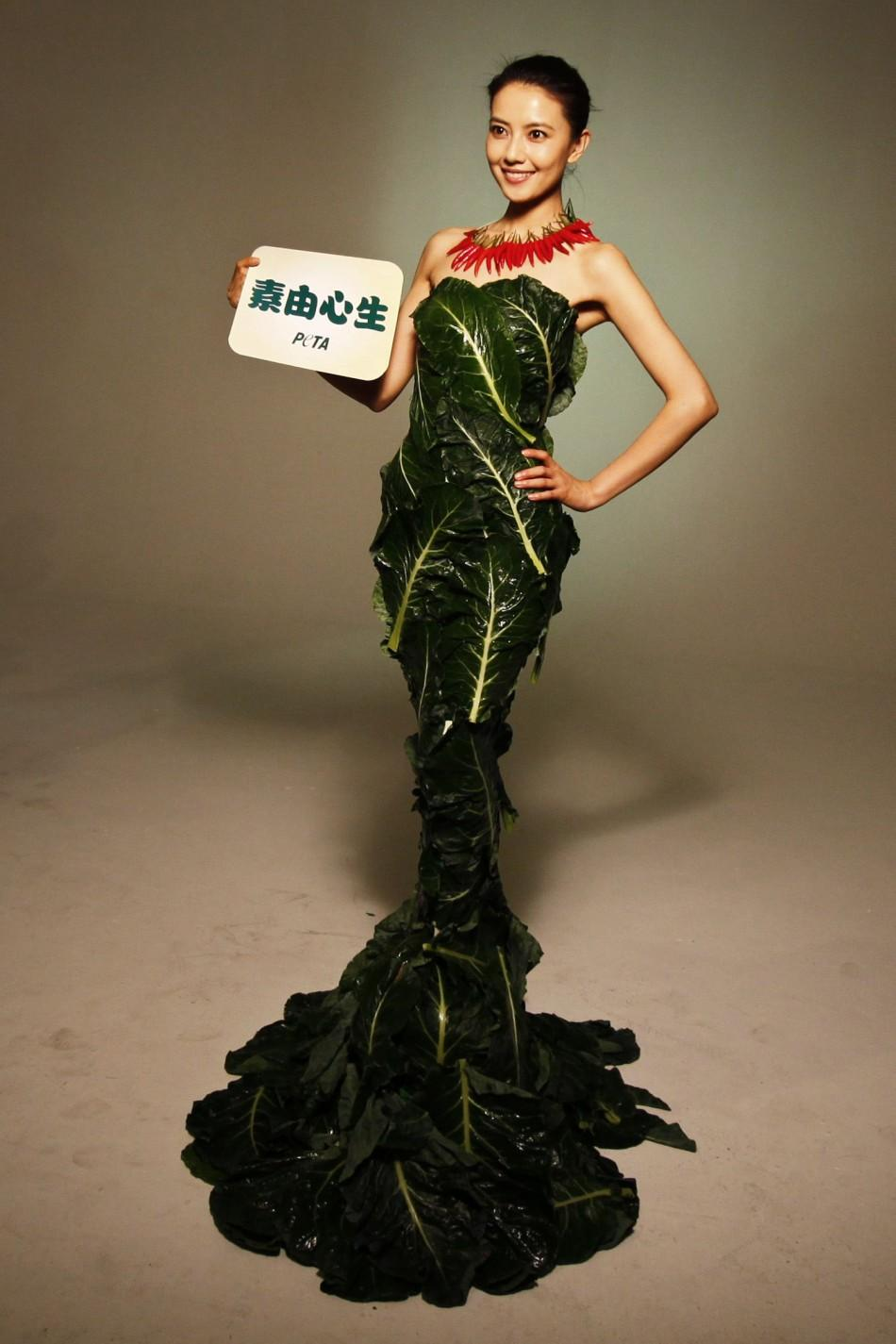 Chinese movie star Gao poses in a gown made of lettuce and cabbage leaves during an event organized by PETA in Beijing