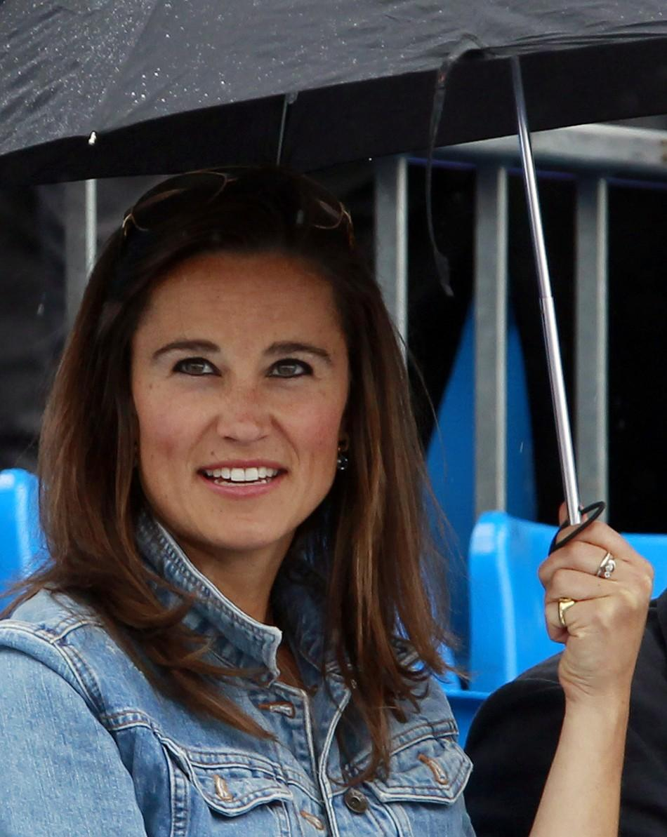 Pippa Middleton, sister of Catherine, Duchess of Cambridge smiles during a rain break at the Queen's Club Championships in west London, on June 9, 2011.
