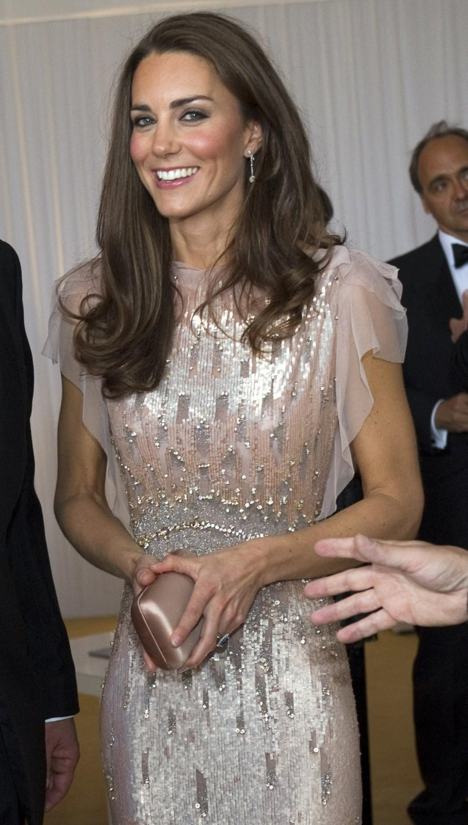 Britain's Catherine, Duchess of Cambridge arrives at ARK gala dinner at Kensington Palace in London