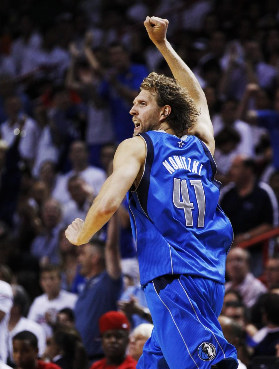 Mavericks' Nowitzki celebrates after making a basket against the Heat during Game 6 of the NBA Finals basketball series in Miami