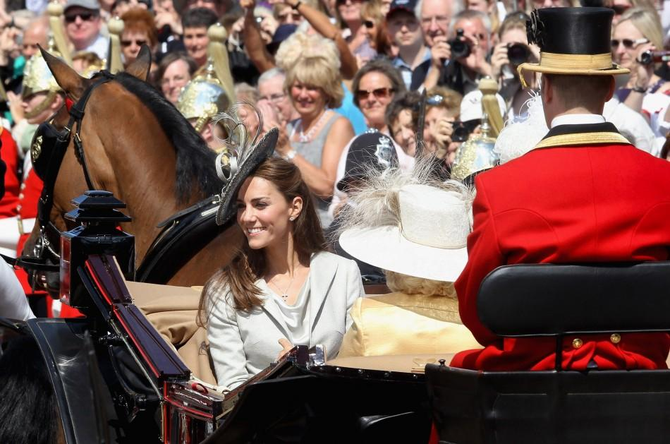 Kate rides a chariot with members of the Royal Family