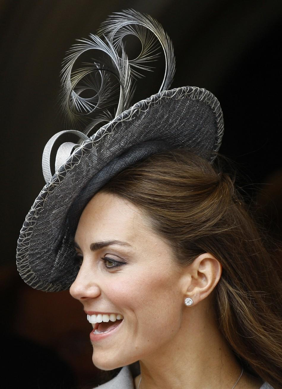 The Duchess of Cambridge smiles as she greets simpletons
