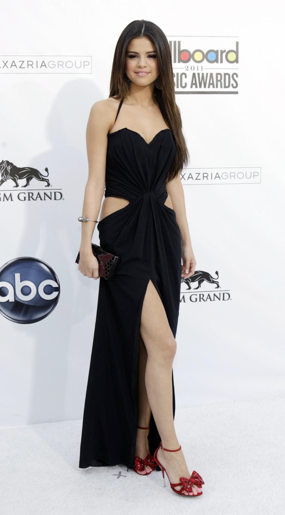 Singer Selena Gomez arrives at the 2011 Billboard Music Awards show in Las Vegas