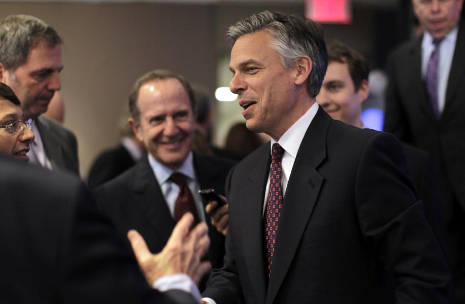 Former Utah Governor Jon Huntsman is greeted after speaking at an event hosted by Thomson Reuters in New York