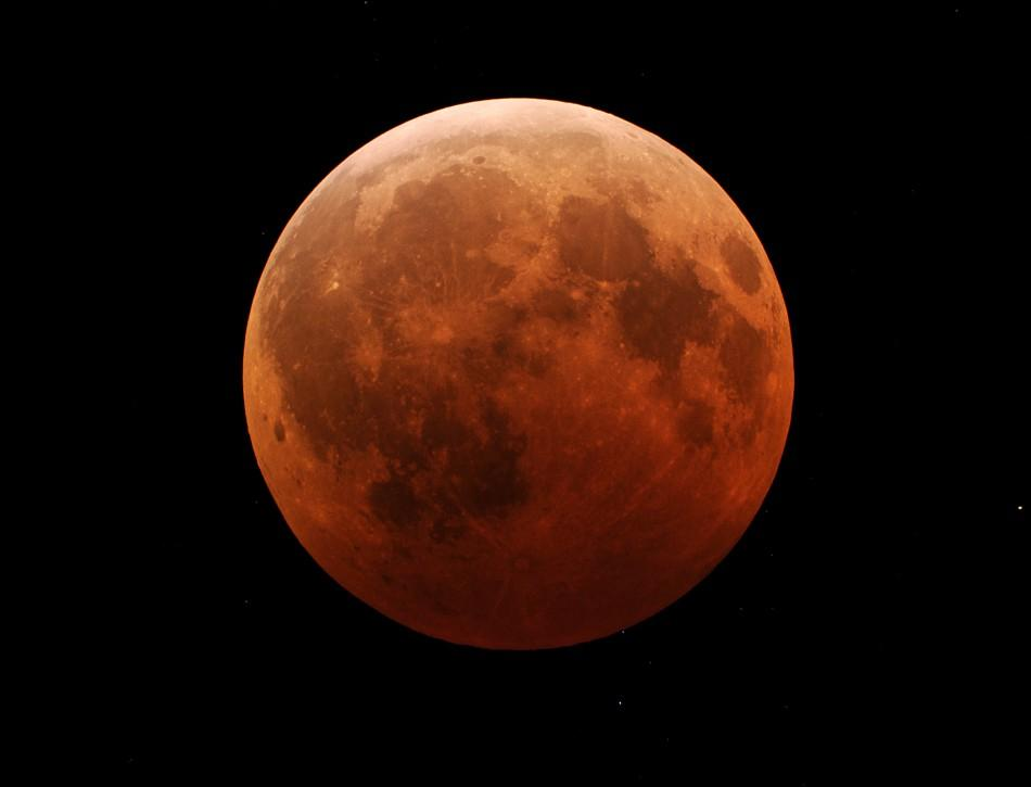 Why would Wednesday's lunar eclipse turn the moon blood-red?