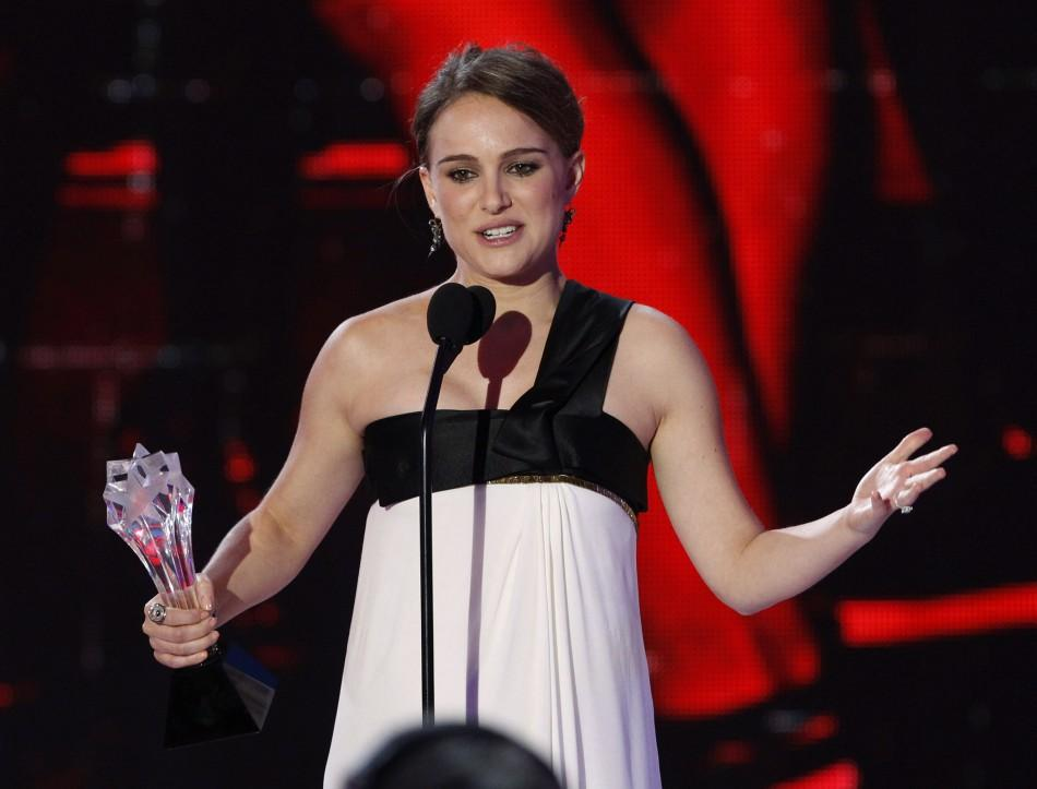 Actress Natalie Portman (L) accepts the award for best actress for her role in 'Black Swan' at the 16th Annual Critics' Choice Movie Awards in Hollywood, California January 14, 2011.