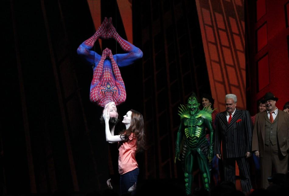 "Cast member Reeve Carney (L) is kissed by fellow cast member Jennifer Damiano (C) during the curtain call for the Broadway opening of ""Spider-Man: Turn Off The Dark"" in New York June 14, 2011."
