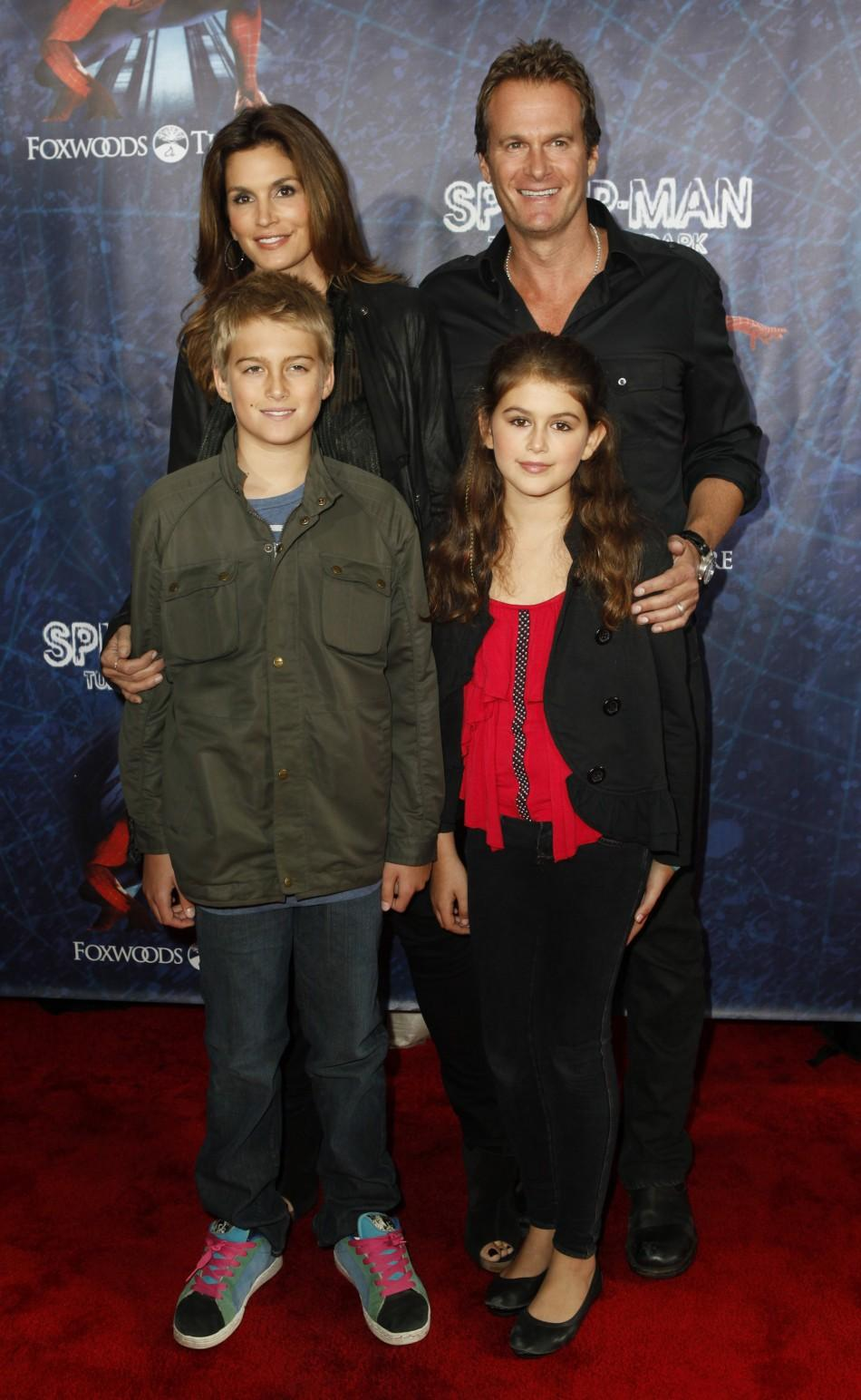 "Model Cindy Crawford, her husband Rande Gerber, and their children, Presley Walker Gerber (front L) and Kaia Jordan Gerber, arrive at the Broadway opening of ""Spider-Man: Turn Off The Dark"" in New York June 14, 2011."