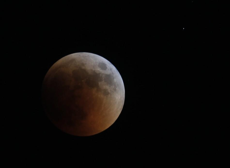 A shadow falls on the moon during a lunar eclipse as seen from Amman