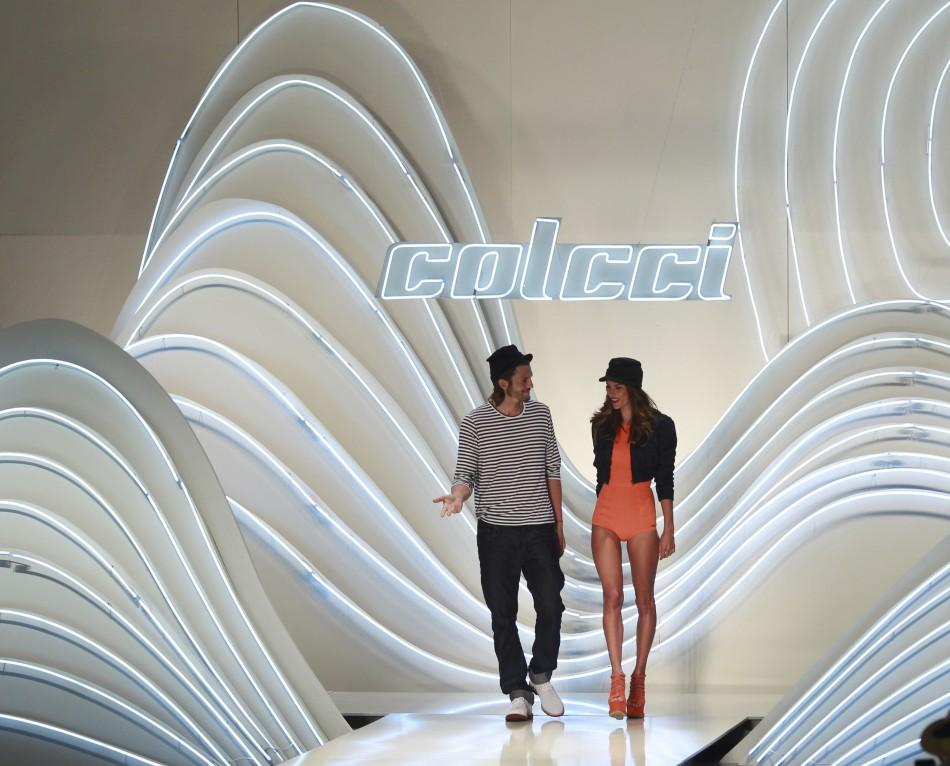 U.S. actor Kutcher and Brazilian model Ambrosio present creations from Colcci's Summer 2012 collection during Sao Paulo Fashion week