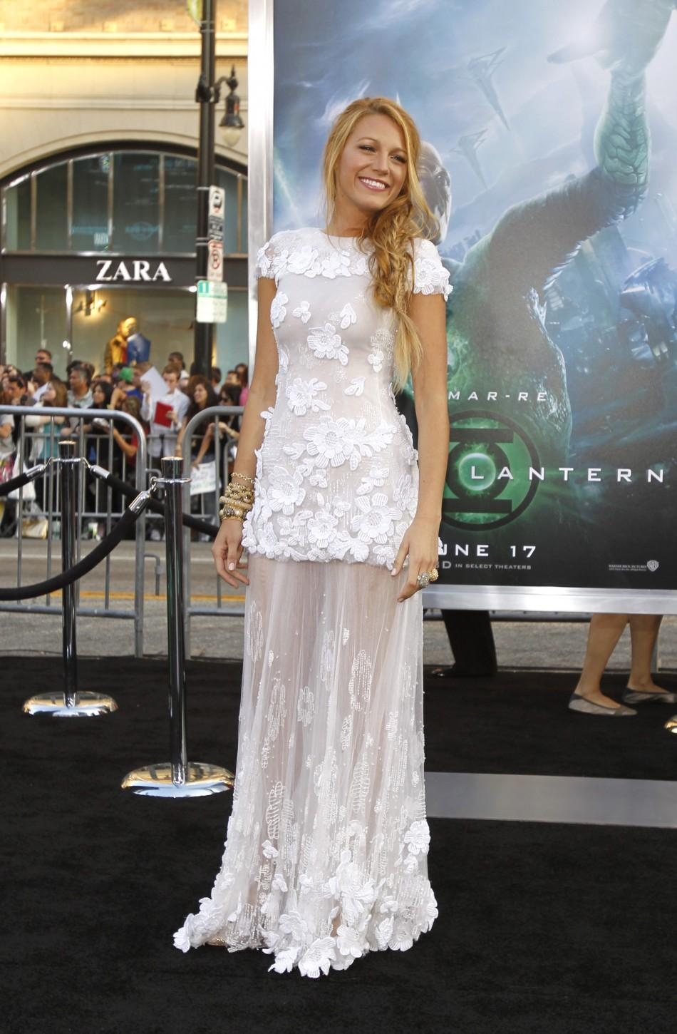 "Cast member Blake Lively poses at the premiere of ""Green Lantern"" at the Grauman's Chinese Theatre in Hollywood, California June 15, 2011."