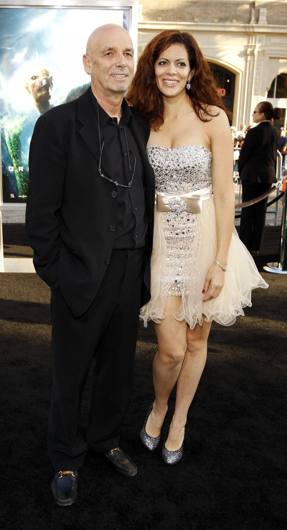 "Director Martin Campbell and his wife Sol E. Romero pose at the premiere of his movie ""Green Lantern"" at the Grauman's Chinese theatre in Hollywood, California June 15, 2011."