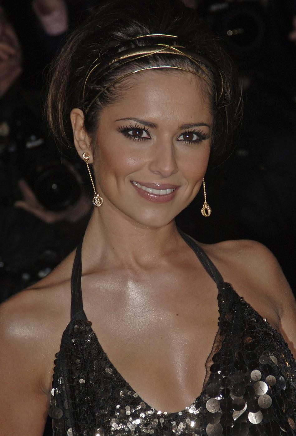 """Singer Cheryl Cole from British group Girls Aloud poses at the world premiere of """"St Trinians"""" in London"""