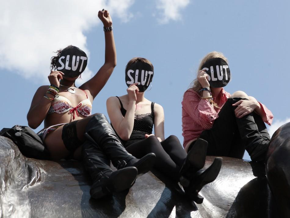 SlutWalk participants cheer a speaker, after walking from Hyde Park Corner, in Trafalgar Square, central London