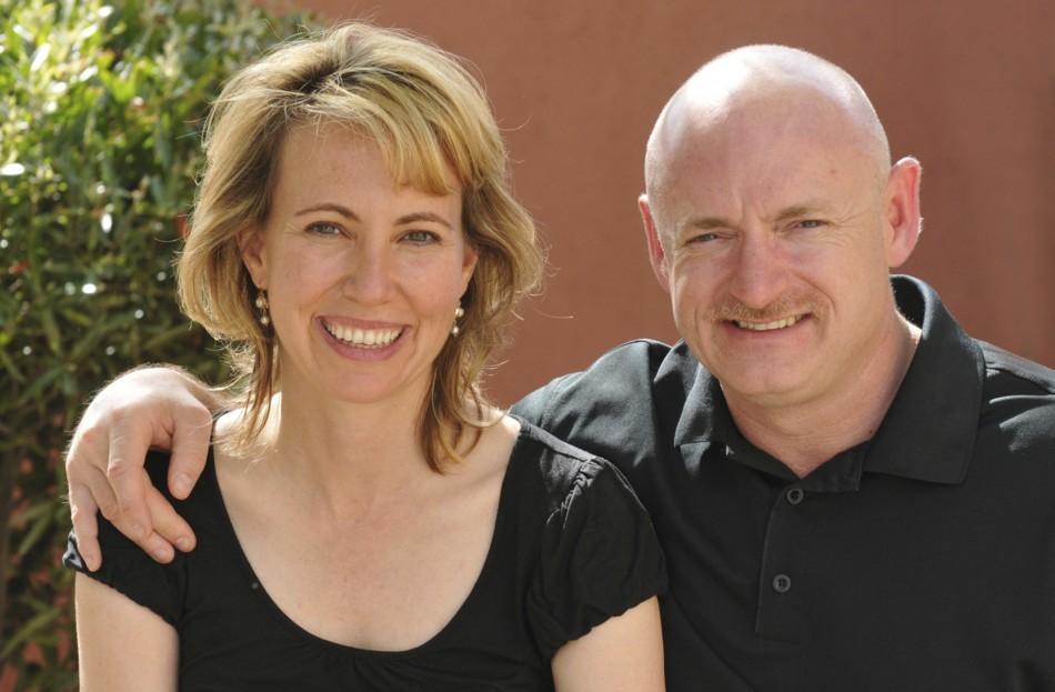 File handout image of U.S. Representative Gabrielle Giffords is seen with her husband Mark Kelly in an undated handout photo